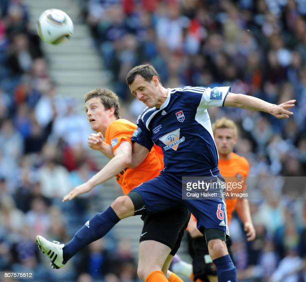 Ross County's Alex Keddie heads the ball clear during the Active Nation Scottish Cup Final at Hampden Park Glasgow