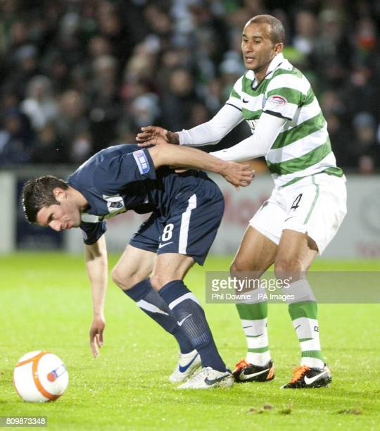 Ross County's Rocco Quinn battles for the ball with Celtic's Badr El Kaddouri during the Scottish Communities League Cup Third Round match at...