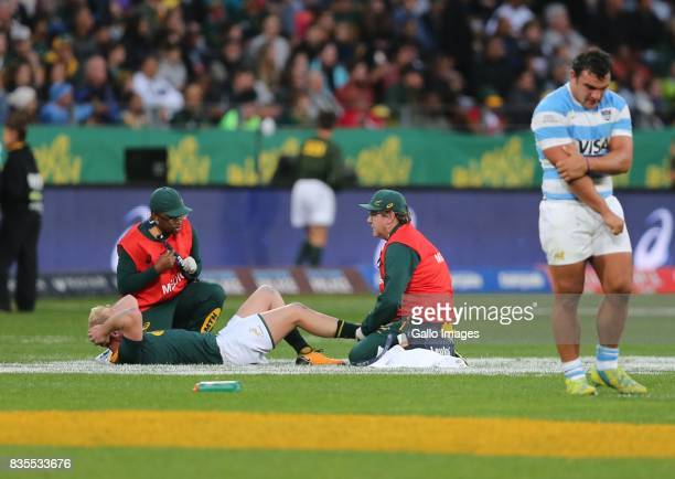 Ross Cronjé of South Africa receives medical attention during the Rugby Championship match between South Africa and Argentina at Nelson Mandela Bay...