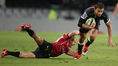 Ross Cronje of the Emirates Lions looks to tackle Pat Lambie of the Cell C Sharks during the Super Rugby match between Cell C Sharks and Emirates...