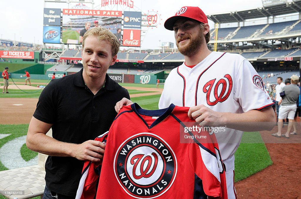 <a gi-track='captionPersonalityLinkClicked' href=/galleries/search?phrase=Ross+Detwiler&family=editorial&specificpeople=4329174 ng-click='$event.stopPropagation()'>Ross Detwiler</a> #48 of the Washington Nationals presents a jersey to Patrick Kane before the game against the Miami Marlins at Nationals Park on August 27, 2013 in Washington, DC.