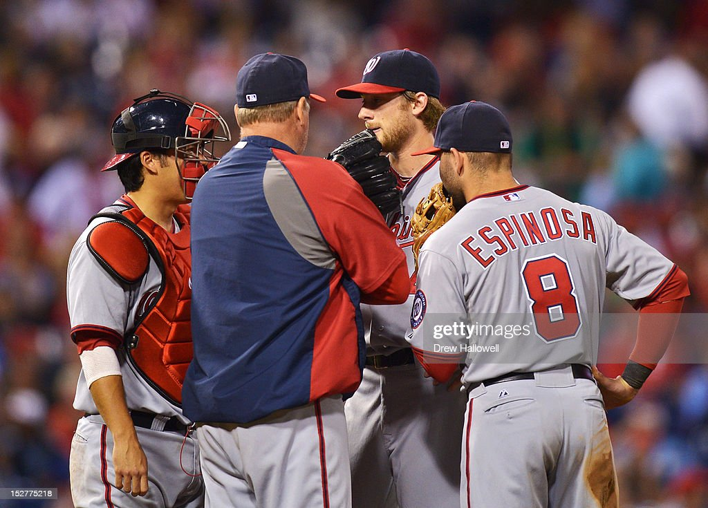 <a gi-track='captionPersonalityLinkClicked' href=/galleries/search?phrase=Ross+Detwiler&family=editorial&specificpeople=4329174 ng-click='$event.stopPropagation()'>Ross Detwiler</a> #48 of the Washington Nationals talks with teammates <a gi-track='captionPersonalityLinkClicked' href=/galleries/search?phrase=Kurt+Suzuki&family=editorial&specificpeople=682702 ng-click='$event.stopPropagation()'>Kurt Suzuki</a> #24, <a gi-track='captionPersonalityLinkClicked' href=/galleries/search?phrase=Danny+Espinosa&family=editorial&specificpeople=4410764 ng-click='$event.stopPropagation()'>Danny Espinosa</a> #8 and pitching coach Steve McCatty #43 during the game against the Philadelphia Phillies at Citizens Bank Park on September 25, 2012 in Philadelphia, Pennsylvania.