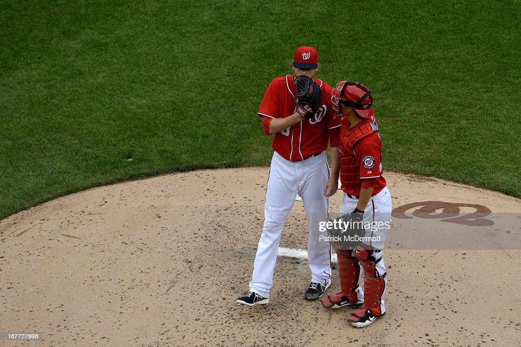 <a gi-track='captionPersonalityLinkClicked' href=/galleries/search?phrase=Ross+Detwiler&family=editorial&specificpeople=4329174 ng-click='$event.stopPropagation()'>Ross Detwiler</a> #48 talks with <a gi-track='captionPersonalityLinkClicked' href=/galleries/search?phrase=Kurt+Suzuki&family=editorial&specificpeople=682702 ng-click='$event.stopPropagation()'>Kurt Suzuki</a> #24 of the Washington Nationals after failing to catch a single hit by Corky Miller #37 of the Cincinnati Reds in the fourth inning of a game at Nationals Park on April 28, 2013 in Washington, DC.