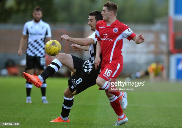 Ross Draper of Inverness is challenged by Sean Dickson of Stirling Albion during the Betfred League Cup match between Stirling Albion and Inverness...