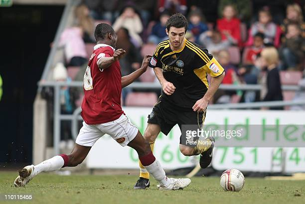 Ross Draper of Macclesfield Town attempts to move past Abdul Osman of Northampton Town during the npower League Two match between Northampton Town...