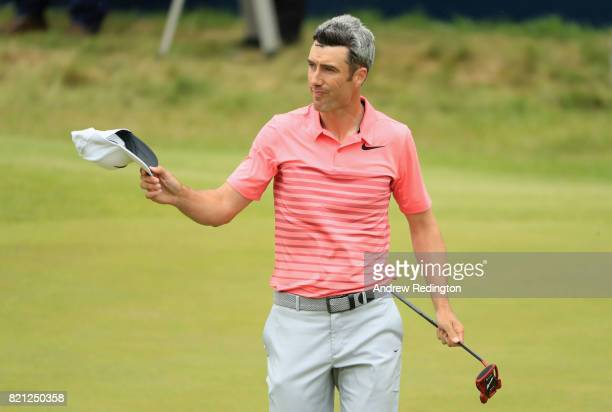 Ross Fisher of England acknowledges the crowd on the 18th hole during the final round of the 146th Open Championship at Royal Birkdale on July 23...