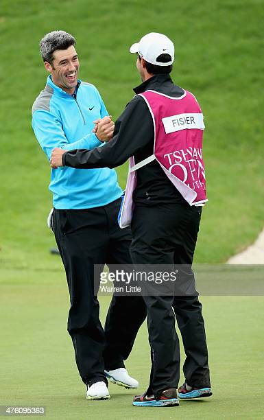 Ross Fisher of England celebrates with his caddie Chris Harmston after winning the Tshwane Open at Copperleaf Golf Country Estate on a score of 20...