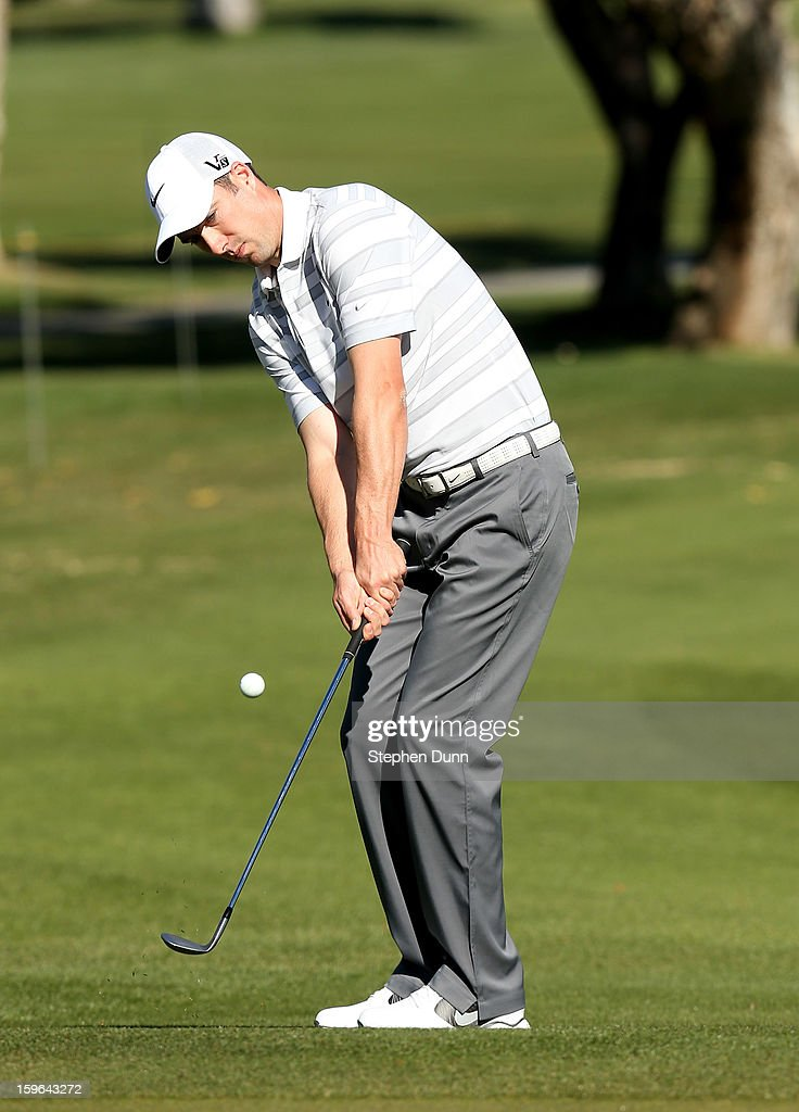 Ross Fisher of England chips onto the green on the sixth hole during the first round of the Humana Challenge in partnership with the Clinton Foundation at La Quinta Country Club on January 17, 2013 in La Quinta, California.