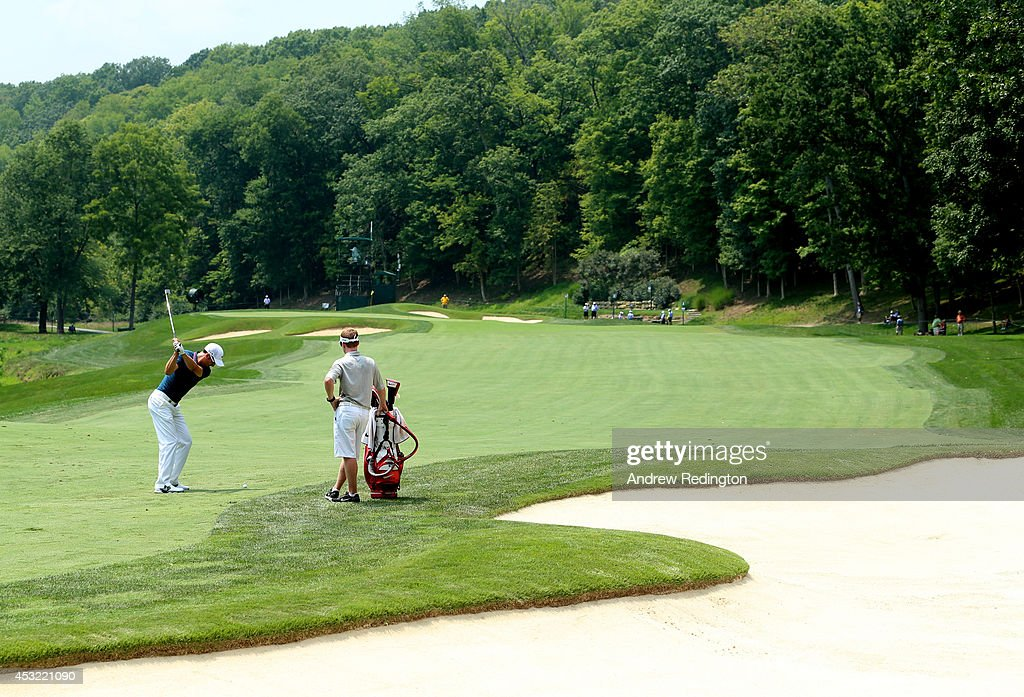 Ross Fisher of England hits a shot during a practice round prior to the start of the 96th PGA Championship at Valhalla Golf Club on August 5 2014 in...