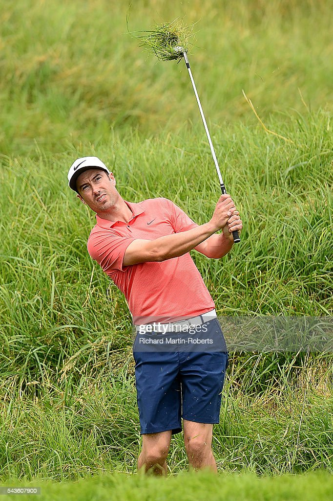<a gi-track='captionPersonalityLinkClicked' href=/galleries/search?phrase=Ross+Fisher&family=editorial&specificpeople=541078 ng-click='$event.stopPropagation()'>Ross Fisher</a> of England hits from the rough during a pro-am round ahead of the 100th Open de France at Le Golf National on June 29, 2016 in Paris, France.
