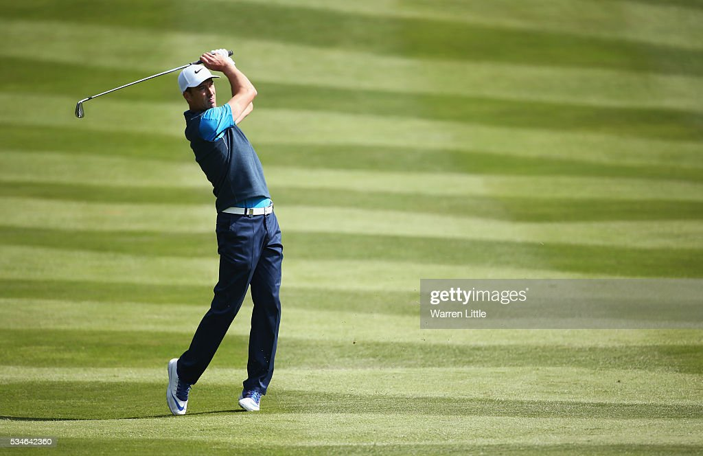 <a gi-track='captionPersonalityLinkClicked' href=/galleries/search?phrase=Ross+Fisher&family=editorial&specificpeople=541078 ng-click='$event.stopPropagation()'>Ross Fisher</a> of England hits his 2nd shot on the 4th hole during day two of the BMW PGA Championship at Wentworth on May 27, 2016 in Virginia Water, England.