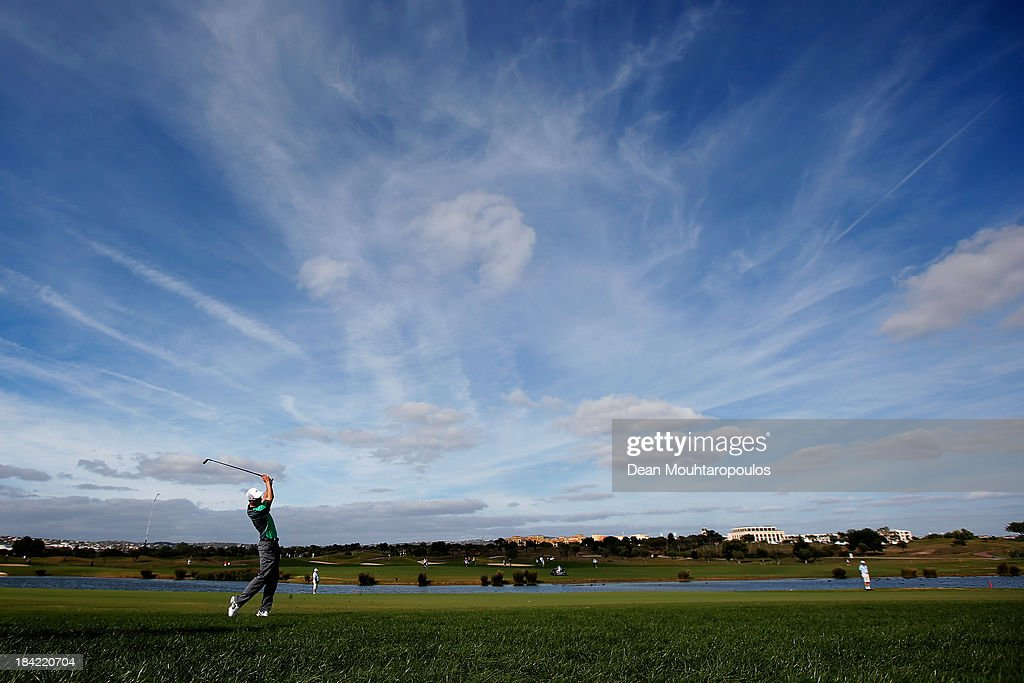 Ross Fisher of England hits his second shot on the 12th hole during the third round of the Portugal Masters at Oceanico Victoria Golf Course on...