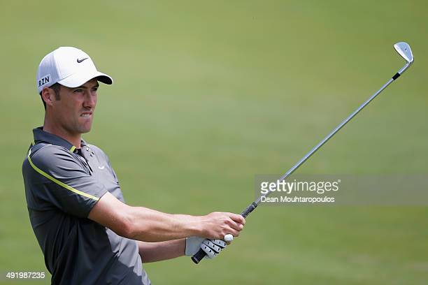 Ross Fisher of England hits his second shot on the 1st hole during the final round of the Open de Espana held at PGA Catalunya Resort on May 18 2014...