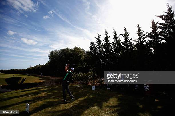 Ross Fisher of England hits his tee shot on the 12th hole during the third round of the Portugal Masters at Oceanico Victoria Golf Course on October...