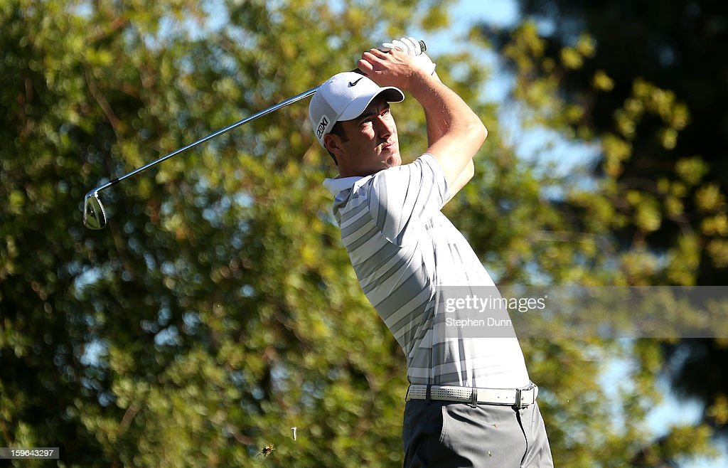 Ross Fisher of England hits his tee shot on the seventh hole during the first round of the Humana Challenge in partnership with the Clinton Foundation at La Quinta Country Club on January 17, 2013 in La Quinta, California.