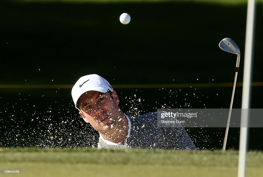 Ross Fisher of England hits out of a bunker on the second hole during the first round of the Humana Challenge in partnership with the Clinton Foundation at La Quinta Country Club on January 17, 2013 in La Quinta, California.