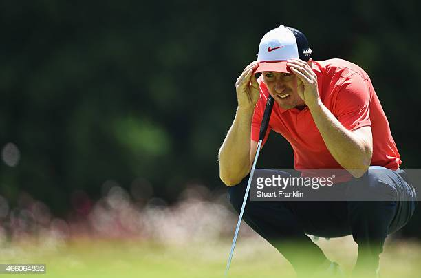Ross Fisher of England lines up a putt during the second round of the Tshwane Open at Pretoria Country Club on March 13 2015 in Pretoria South Africa