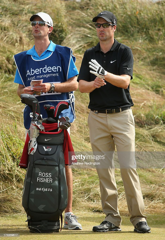 <a gi-track='captionPersonalityLinkClicked' href=/galleries/search?phrase=Ross+Fisher&family=editorial&specificpeople=541078 ng-click='$event.stopPropagation()'>Ross Fisher</a> of England looks on with caddie Adam Marrow during the second round of the Aberdeen Asset Management Scottish Open at Castle Stuart Golf Links on July 12, 2013 in Inverness, Scotland.