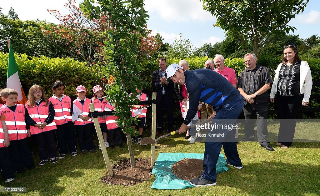 <a gi-track='captionPersonalityLinkClicked' href=/galleries/search?phrase=Ross+Fisher&family=editorial&specificpeople=541078 ng-click='$event.stopPropagation()'>Ross Fisher</a> of England plants a tree in Rowan Tree Park during visit by Leixlip ambassador <a gi-track='captionPersonalityLinkClicked' href=/galleries/search?phrase=Ross+Fisher&family=editorial&specificpeople=541078 ng-click='$event.stopPropagation()'>Ross Fisher</a> prior to the Irish Open at Carton House Golf Club on June 26, 2013 in Maynooth, Ireland.
