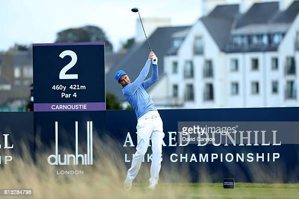 Ross Fisher of England plays a drive off the second tee during the third round of the Alfred Dunhill Links Championship at Carnoustie Golf Links on...