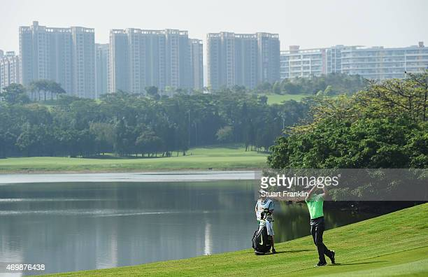 Ross Fisher of England plays a shot during the first round of the Shenzhen International at Genzon Golf Club on April 16 2015 in Shenzhen China