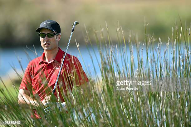 Ross Fisher of England plays a shot during the pro am prior to the start of the Portugal Masters at Oceanico Victoria Golf Club on October 8 2014 in...