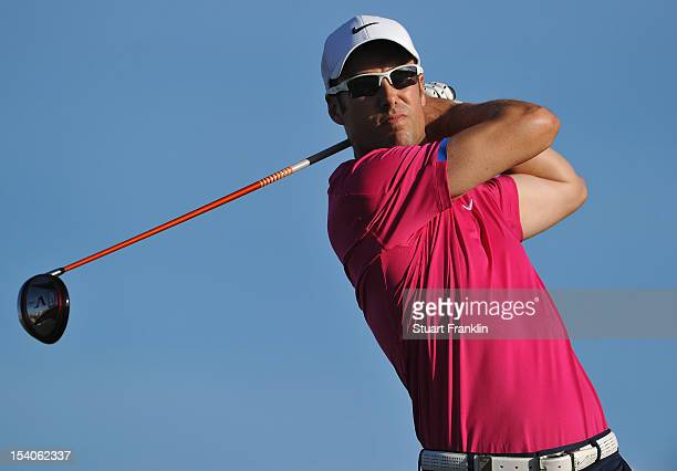 Ross Fisher of England plays a shot during the third round of the Portugal Masters at the Victoria golf course at Villamoura on October 13 2012 in...