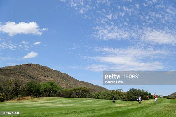 Ross Fisher of England plays his third shot into the 14th green during the third round of the Nedbank Golf Challenge at the Gary Player CC on...