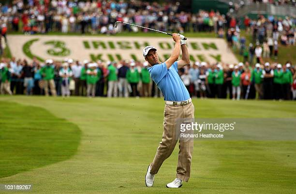 Ross Fisher of England plays into the 18th green during the final round of the 3 Irish Open at Killarney Golf and Fishing Club on August 1 2010 in...