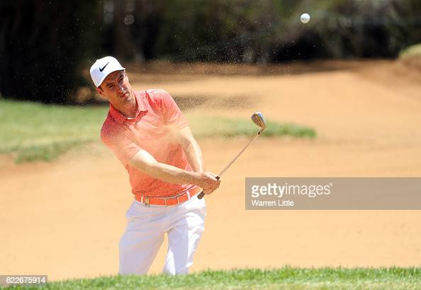 Ross Fisher of England plays out of the 12th greenside bunker during the third round of the Nedbank Golf Challenge at the Gary Player CC on November...