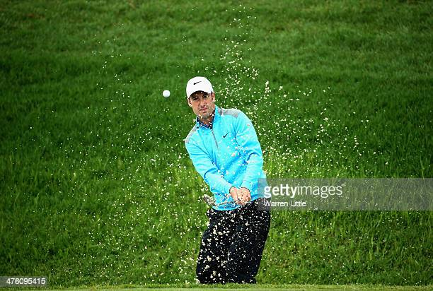Ross Fisher of England plays out of the 18th greenside bunker during the final round of the Tshwane Open at Copperleaf Golf Country Estate on March 2...