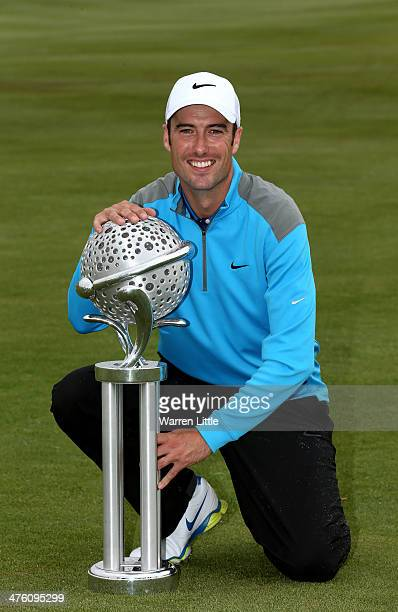 Ross Fisher of England poses with the trophy after winning the Tshwane Open on a score of 20 under par at Copperleaf Golf Country Estate on March 2...