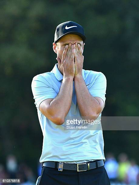 Ross Fisher of England reacts after a missed put on the 18th green during the final round of the Porsche European Open at Golf Resort Bad Griesbach...