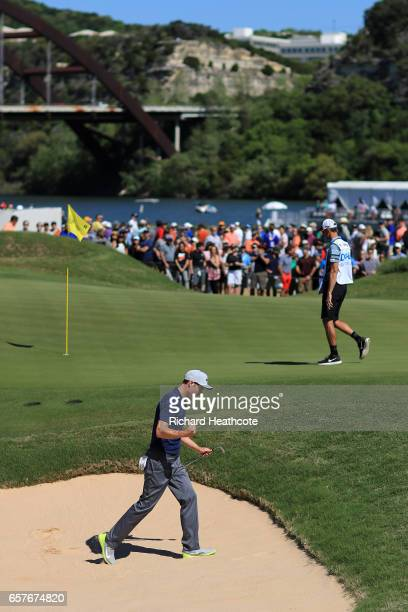 Ross Fisher of England reacts after holing out of a bunker on the 15th hole to beat Bubba Watson 43 during round four of the World Golf...