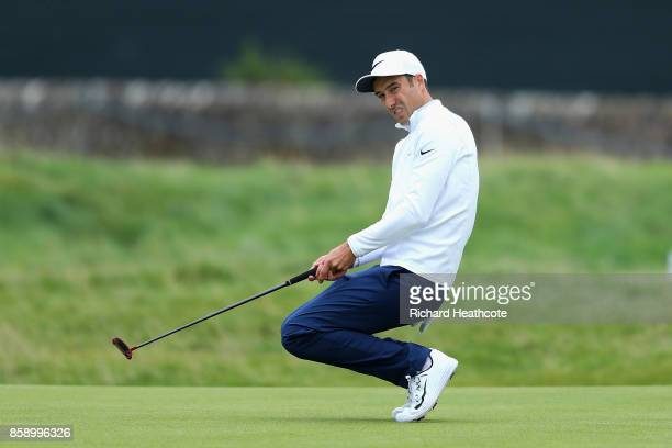 Ross Fisher of England reacts to a putt on the 15th green during the final round of the 2017 Alfred Dunhill Championship at The Old Course on October...