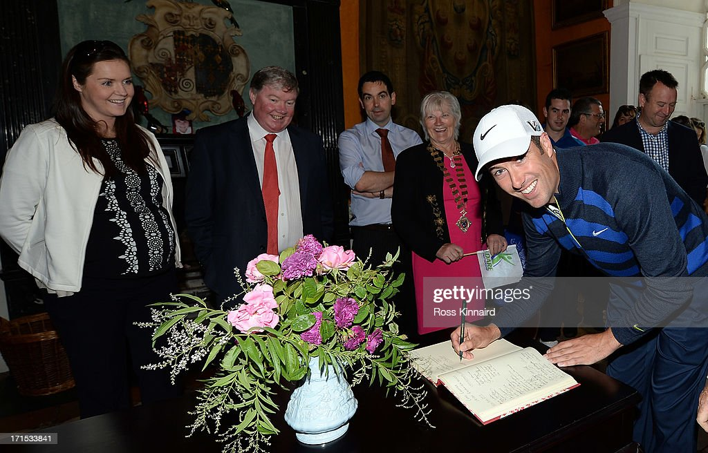 <a gi-track='captionPersonalityLinkClicked' href=/galleries/search?phrase=Ross+Fisher&family=editorial&specificpeople=541078 ng-click='$event.stopPropagation()'>Ross Fisher</a> of England signs the visitors book in Leixlip Castle during visit by Leixlip ambassador <a gi-track='captionPersonalityLinkClicked' href=/galleries/search?phrase=Ross+Fisher&family=editorial&specificpeople=541078 ng-click='$event.stopPropagation()'>Ross Fisher</a> prior to the Irish Open at Carton House Golf Club on June 26, 2013 in Maynooth, Ireland.