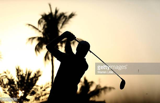 Ross Fisher of England tees off on the 10th hole during the first round of the Omega Dubai Desert Classic on the Majlis course at the Emirates Golf...