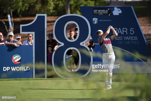 Ross Fisher of England tees off on the 18th hole during the final round of the DP World Tour Championship at Jumeirah Golf Estates on November 19...