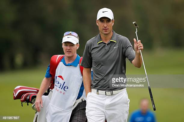 Ross Fisher of England thanks the fans for their applause on the 18th hole during the final round of the Open de Espana held at PGA Catalunya Resort...
