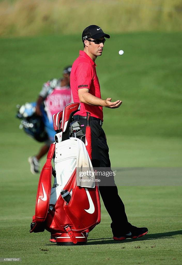 <a gi-track='captionPersonalityLinkClicked' href=/galleries/search?phrase=Ross+Fisher&family=editorial&specificpeople=541078 ng-click='$event.stopPropagation()'>Ross Fisher</a> of England tosses his ball as he waits to play during the second round of the Tshwane Open at Copperleaf Golf & Country Estate on February 28, 2014 in Centurion, South Africa.
