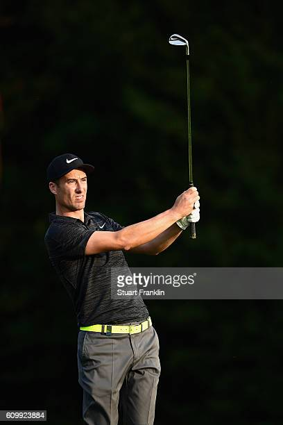 Ross Fisher of England watches the flight of his ball after playing an iron shot during the second round on day two of the Porsche European Open at...