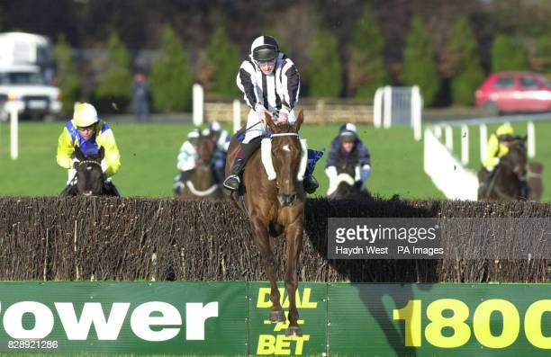 Ross Geraghty riding Cloudy Bays over the last fence before winning the Pierse Leopardstown Handicap Chase at Leopardstown Racecourse Dublin Ireland