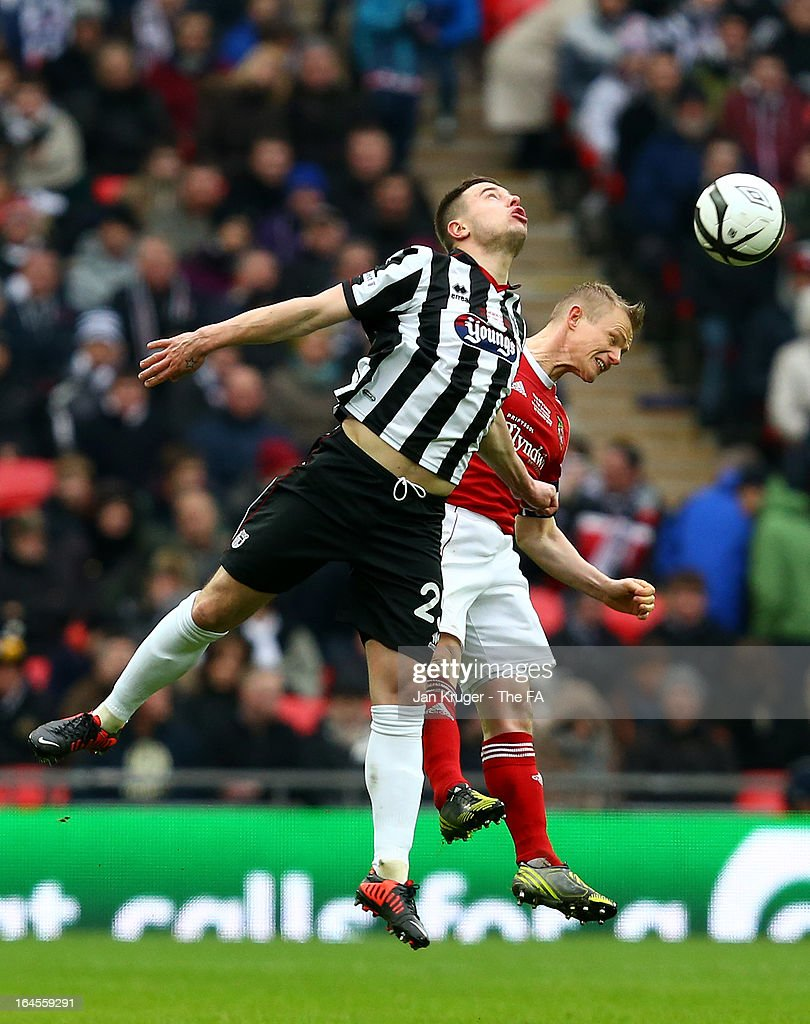 Ross Hannah of Grimsby Town and Dean Keates of Wrexham competes for the arial ball during the FA Trophy Final between Wrexham and Grimsby Town at Wembley Stadium on March 24, 2013 in London, England.