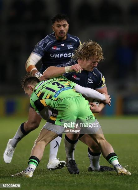 Ross Harrison of Sale Sharks is tackled by Roy Hutchinson of Northampton during the Aviva Premiership match between Sale Sharks and Northampton...