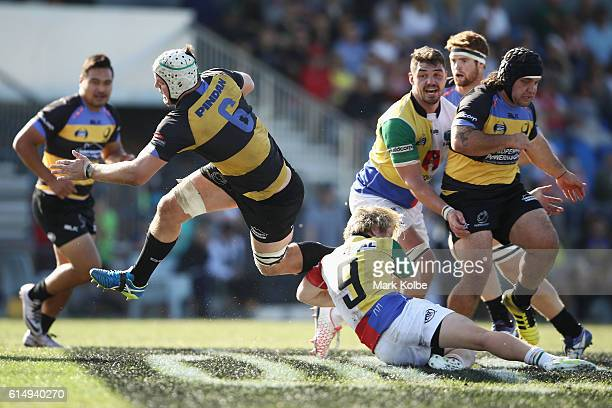 Ross HaylettPetty of the Spirit is tackled during the NRC Semi Final match between the Sydney Rays and Perth Spirit at Pittwater Park on October 16...