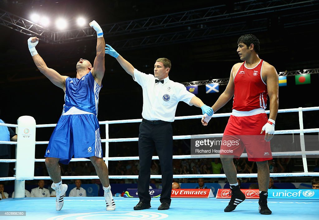 Ross Henderson of Scotland (blue) celebrates victory over Parveen Parveen Kumar of India in the Men's Super Heavy +91kg preliminaries at Scottish Exhibition And Conference Centre during day two of the Glasgow 2014 Commonwealth Games on July 25, 2014 in Glasgow, United Kingdom.