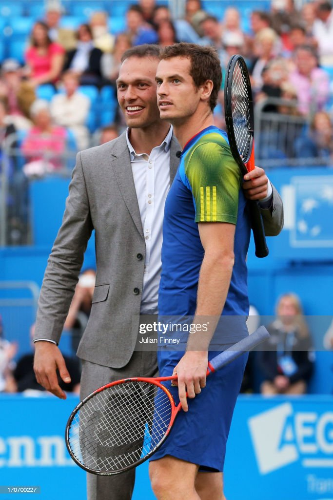 <a gi-track='captionPersonalityLinkClicked' href=/galleries/search?phrase=Ross+Hutchins&family=editorial&specificpeople=2365752 ng-click='$event.stopPropagation()'>Ross Hutchins</a> and <a gi-track='captionPersonalityLinkClicked' href=/galleries/search?phrase=Andy+Murray+-+Tennis+Player&family=editorial&specificpeople=200668 ng-click='$event.stopPropagation()'>Andy Murray</a> on court during the Rally Against Cancer charity match on day seven of the AEGON Championships at Queens Club on June 16, 2013 in London, England.
