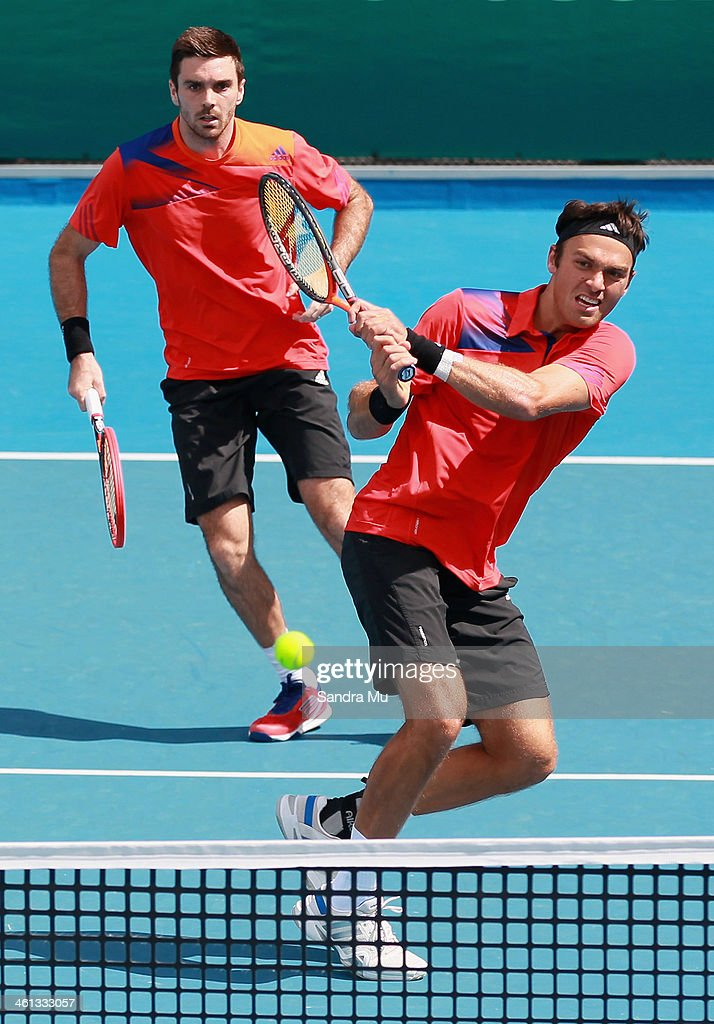 <a gi-track='captionPersonalityLinkClicked' href=/galleries/search?phrase=Ross+Hutchins&family=editorial&specificpeople=2365752 ng-click='$event.stopPropagation()'>Ross Hutchins</a> (R) and Colin Fleming (L) of Great Britain during their doubles match against Andre Begemann and Martin Emmrich of Germany on day three of the Heineken Open at ASB Tennis Centre on January 8, 2014 in Auckland, New Zealand.
