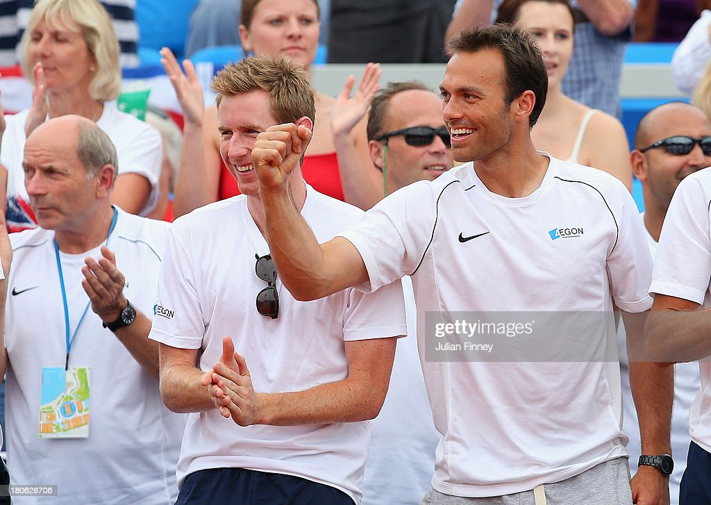 Ross Hutchins and Jonny Marray of Great Britain support Daniel Evans of Great Britain against Mate Pavic of Croatia during day three of the Davis Cup World Group play-off tie between Croatia and Great Britain at Stadion Stella Maris on September 15, 2013 in Umag, Croatia.