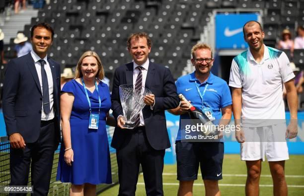 Ross Hutchins former tennis player title sponsor from Aegon Tara McGregor Tournament Director Stephen Farrow the Queen's Club's groundsman Graham...